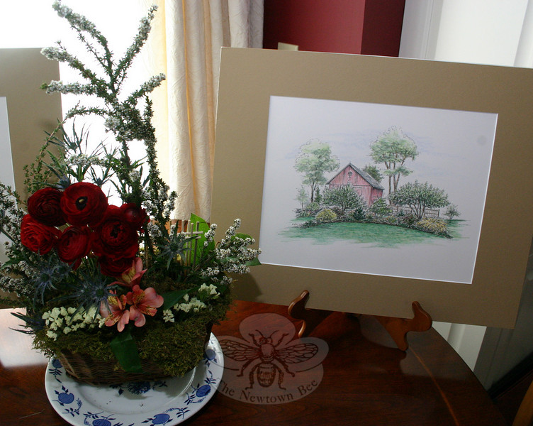 Garden Club of Newtown members created floral arrangements to complement the illustrations of Kim Proctor that were displayed during a special event at The Dana-Holcombe House on May 2.  (Hicks photo)