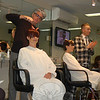 Working simultaneously in front of a class of more than three dozen area stylists, Sassoon experts Stephen Moody, left, and Kenny Reid demonstrated the newest cutting and coloring techniques.  (Crevier photo)