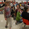 Rachel Wood, daughter of Jonathan Wood, who gave a presentation at Head O'Meadow on April 29, carried one of the birds introduced to students during the event.  (Hallabeck photo)