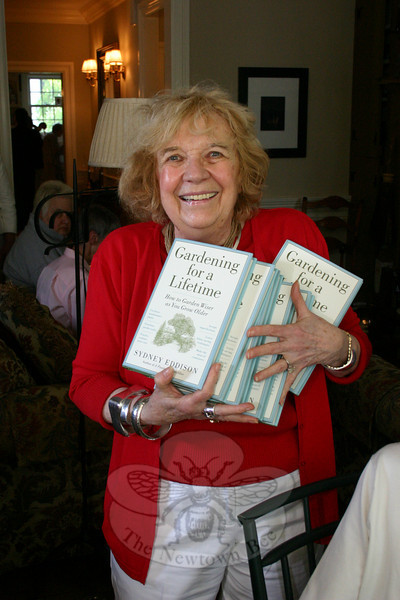 """Everybody's getting a signed copy for Mother's Day!"" promised Mae Schmidle, holding a pile of books she had just purchased.  (Hicks photo)"