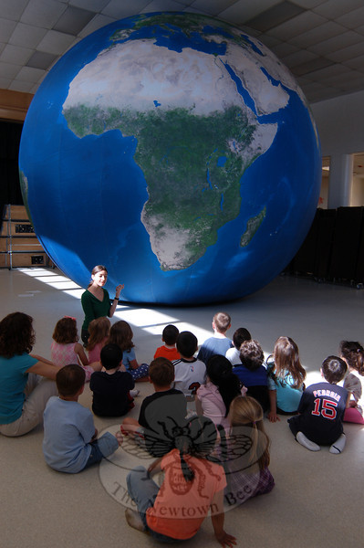 Kindergarten students at Sandy Hook School learned about Earth on Wednesday, April 7, when Sonya Robins visited the school. Ms Robins shared information about Earth with the students by using an Earth balloon to pinpoint areas like water, deserts, and lakes.  (Hallabeck photo)