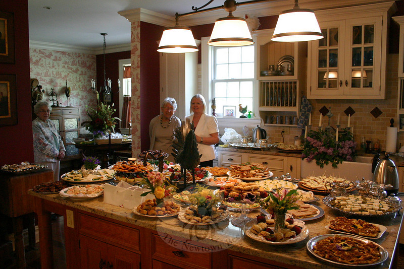 Nancy Whittamore, Margaret Clark and Kathy Williams were in the kitchen of The Dana-Holcombe House with the refreshments ready to go, while Sydney Eddison was in another room of the bed-and-breakfast offering a reading from her new book.  (Hicks photo)