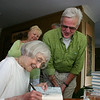 Sydney Eddison signed dozens of copies of Gardening for a Lifetime during a book reading and reception hosted by The Garden Club of Newtown in her honor on Sunday, May 2. Mrs Eddison opened the program with a 45-minute reading from the new collection of essays. Among those for whom she signed books on Sunday afternoon was fellow master gardener Larry Birch, who was surprised to learn he had been among those honored by Mrs Eddison in the opening pages of her newest release.  (Hicks photo)