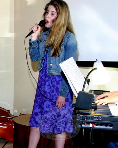 "Clare Boyle, with accompaniment by Francine Wheeler, sang ""No One is Alone."" Later in the program she also read a poem she had written.  (Hicks photo)"