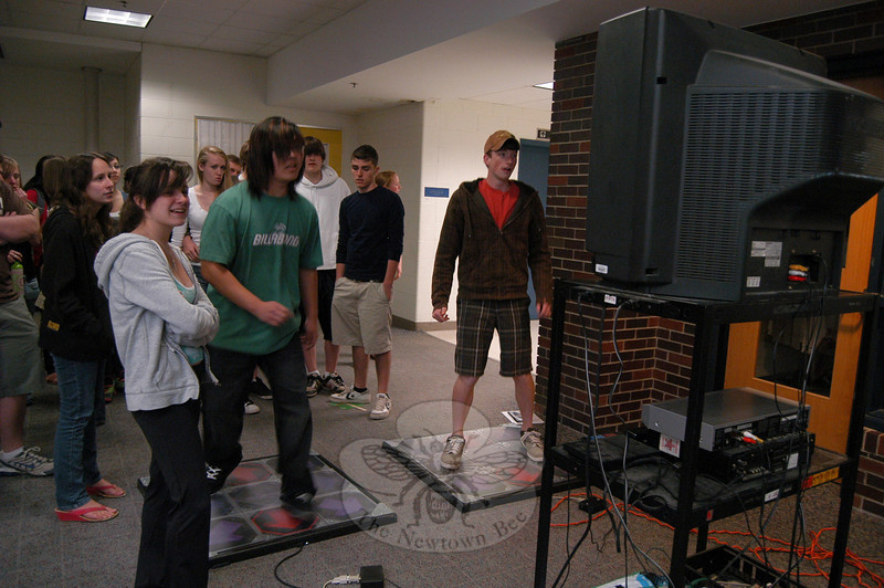 Newtown High School students Jay Lee, left, and Matt Bobkowski played a dance video game during the school's Health Fair on Wednesday, April 28.  (Hallabeck photo)