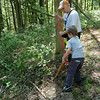 The 4th Annual Nettleton Preserve restoration event, called the Everyday Is Earth Day Trail Clean Up and Preserve Restoration Day, had scouts from Troop 470 and other volunteers assisting Newtown Forest Association members walking the trails and doing their part to cleanup, clear the brush, and more on Saturday, May 1. Troop 470 Scout Gus Coffey and his father, Don, worked together on one of the trails at the Old Castle Drive property.  (Hallabeck photo)