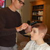 "Malibu Sassoon stylist/educator Stephen Moody touches up the haircut on Ricci's Academy student Satira Moffat before Monday afternoon's class. Mr Moody was invited by the academy's owner, Dan Ricci, to ""regenerate"" area stylists with new ideas.  (Crevier photo)"