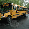 Police report a collision involving a school bus and a compact sedan about 3:15 pm Tuesday, May 4, at the four-way intersection of Button Shop Road and Little Brook Lane. There were no injuries. Police said Frederick Bassett, 61, of 80 Birch Hill Road was driving full-size school bus #21 southward on Little Brook Lane and was going through the intersection, while motorist Brian Corbett, 16, of Southbury was driving a 2007 Toyota Corolla sedan westward on Button Shop Road. Police said Corbett was unable to stop the Toyota at a stop sign and then struck the left, middle section of the bus. There was one passenger on the bus, an unidentified 12-year-old girl who was sitting on the right side of the vehicle, near the front of the bus, police said. The Toyota was heavily damaged in the crash. The bus received a minor dent. Botsford firefighters responded to the accident to contain spilled automotive fluids. Police issued Corbett an infraction for failure to obey a stop sign.  (Gorosko photo)