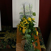 "Garden Club of Newtown members created floral arrangements to complement the illustrations of Kim Proctor that were displayed during a special event at The Dana-Holcombe House on May 2. Paula Stephan did this arrangement, called ""Daffodils on the Hill."" (Hicks photo)"
