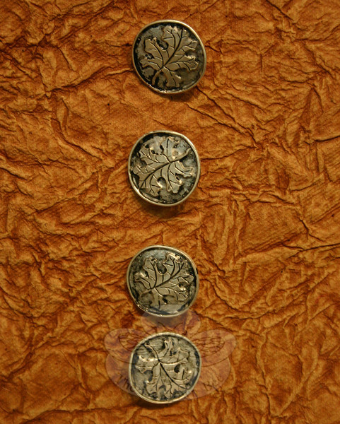 Newtown resident Rachel Morris has a number of items included in the Brookfield Craft Center Student Show & Sale, including these sterling buttons with oak leaf designs.  (Hicks photo)