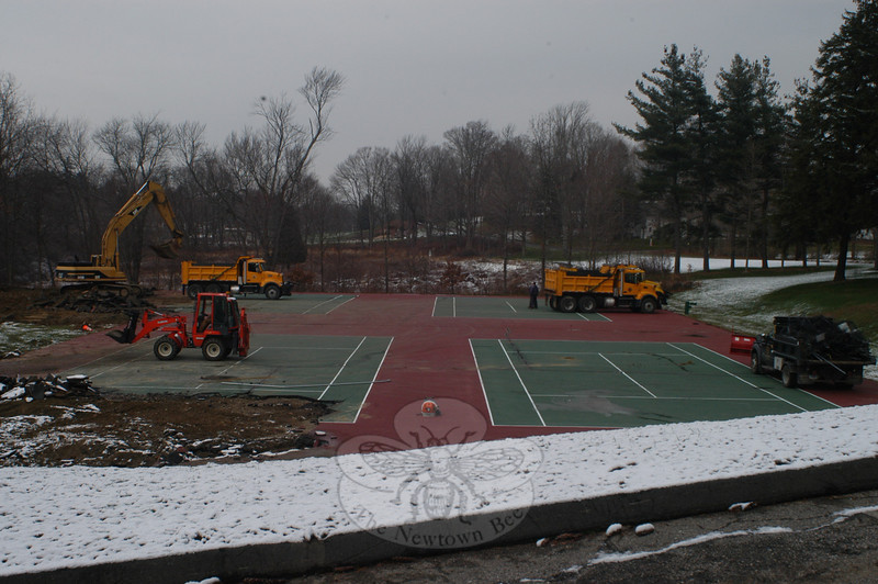The Parks and Recreation Department's Capital Improvement Plan funding of more than $700,000 in combined projects approved for 2009-2010 includes a complete tennis court rebuild, according to Director Amy Mangold. As part of the Dickinson infrastructure work, residents will  see refinished tennis and basketball courts, parking lot improvements, and upgrades to the pavilion. Recreation crews are currently hauling away demolition debris, and soon bids for a rebuild will go out. The new courts, complete with better drainage, are expected to be ready for tennis by Memorial Day weekend.  (Hutchison photo)