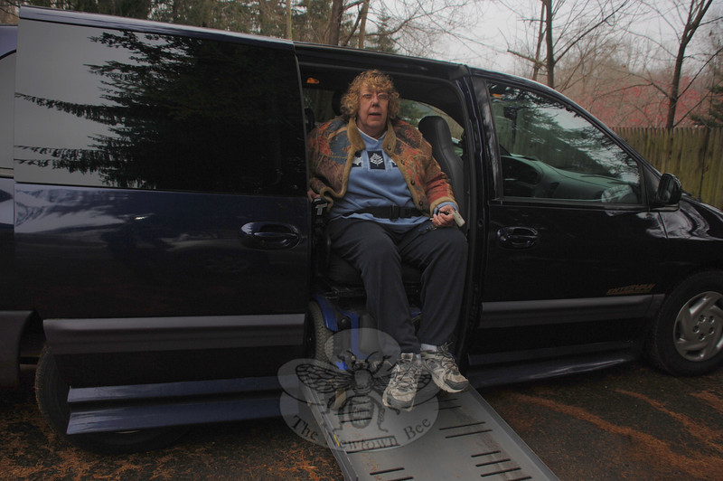 Automatic doors and ramp allow Fran Walczak easy access into and out of her new van. Having a reliable, handicap adapted vehicle has returned her independence, she says, and will allow her to seek employment once again.  (Crevier photo)