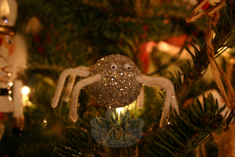 """It doesn't have to be fancy — mine is a Styrofoam ball covered with silver glitter and two glued-on googly eyes,"" says Shannon Hicks of the spider that gets hidden in her Christmas tree each year. Miss Hicks is following a tradition handed down from her grandmother and mother in doing this.  (Hicks photo)"