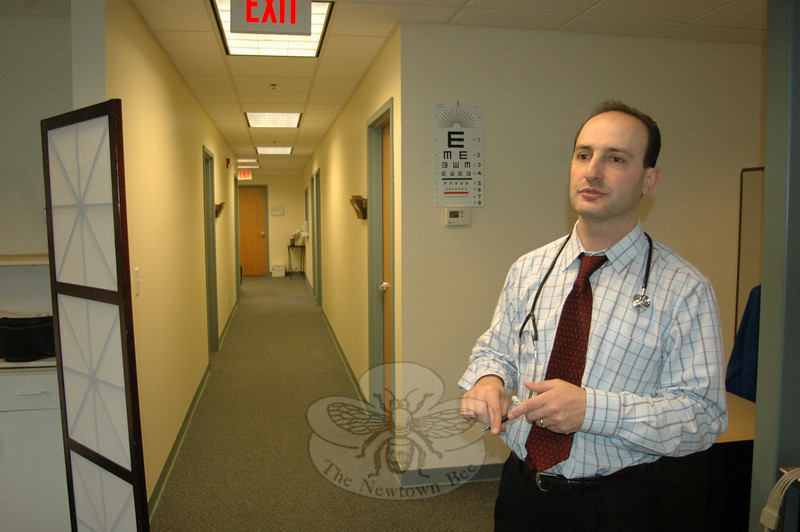 Founder Dr Z. Michael Taweh stands at the end of a hallway full of private examination rooms during the second full day of operation at Kevin's Community Center's new location at 153 South Main Street. He told The Newtown Bee this week that the clinic's new and increased capacity will permit up to ten percent of patients from outside Newtown to receive services.  (Voket photo)