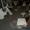 Art Enrichment students in Newtown Middle School teacher Arlene Spoonfeather's class worked on studies of a bike wrapped in cloth Tuesday, December 15. The activity is part of the students' study of the artists Christo and Jeanne-Claude, a husband and wife duo known for wrapping objects, surrounding islands in fabric, and more.  (Hallabeck photo)