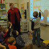 Head O'Meadow teacher Jill Dunn helped students use a SmartBoard to measure the length of a basketball court by moving basketballs on the screen across the length of the court.    (Hallabeck photo)