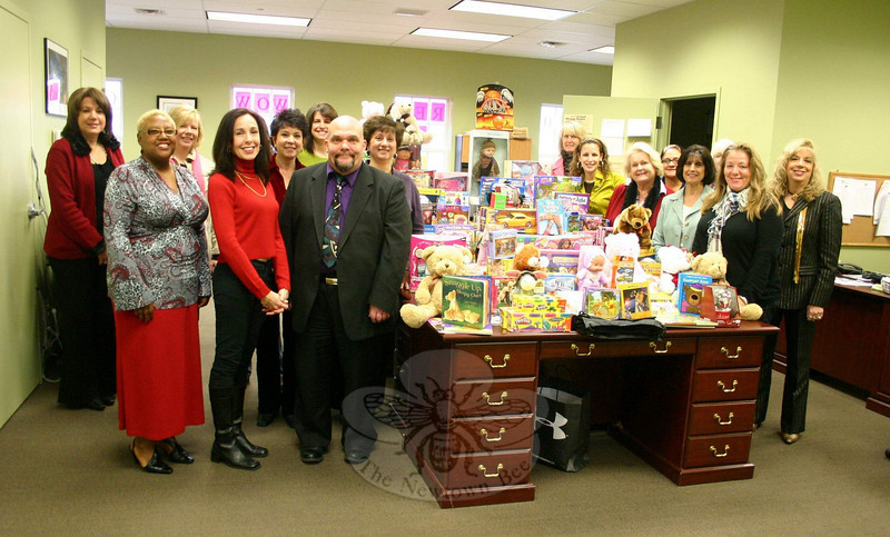 Network For Free recently launched its first Toys For Kids drive, and the resulting donations were distributed among three groups earlier this week. Group founder Scott Blanchard, to the left of the table, who is a loan officer for Mortgage Force in Newtown, celebrated the successful completion of the toy drive at his Church Hill Road office on December 14. For one month, toys were dropped off at locations in Newtown and New Fairfield. Representatives from all of those locations gathered with Mr Blanchard to see the result of the collection on Tuesday morning. With Mr Blanchard are staff members from Community Action Committee of Danbury (CACD), Bentley Dry Cleaning, Maryann Simmons Primerica, the News-Times, Newtown Youth Academy, Next Level iMedia, Nina Nails, Webster Bank, William Raveis Mortgage, and William Raveis Real Estate, all of whom received donations. Also collecting Toys For Kids but unable to attend Tuesday's finale were Danbury Youth Services, Shaolin Services, and Villa Pasta in New Fairfield. Mr Blanchard's family and members of Network For Free also provided donations, which were divided among CACD, Danbury Youth Services, and Newtown Youth Academy, which has volunteered to help families this season.  (Hicks photo)