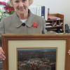 First Selectman Pat Llodra displays an aerial photograph of Fairfield Hills in full operation circa 1985, which was donated by Sandy Hook residents Sue and Jim Shpunt. Mrs Llodra said the image could anchor a historic exhibit of artifacts and memorabilia commemorating the history of Fairfield Hills prior to its acquisition by Newtown.  (Voket photo)
