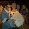 The Kirkman family sat in for the Holy Family on Saturday night, December 12, during St Rose of Lima's annual Living Nativity Scene. Chris Kirkman portrayed Joseph, Kirsten Kirkman, Mother Mary, and Liam Kirkman, warm in swaddling cloths, lay in for the part of baby Jesus.  (Hallabeck photo)