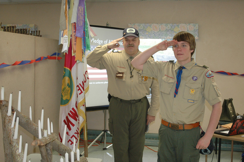 Scoutmaster Ed Breitling and Senior Patrol Leader Mark Malia III salute on the presentation of the colors during Troop 70's awards dinner, which was held March 20 at Newtown United Methodist Church.  (Voket photo)
