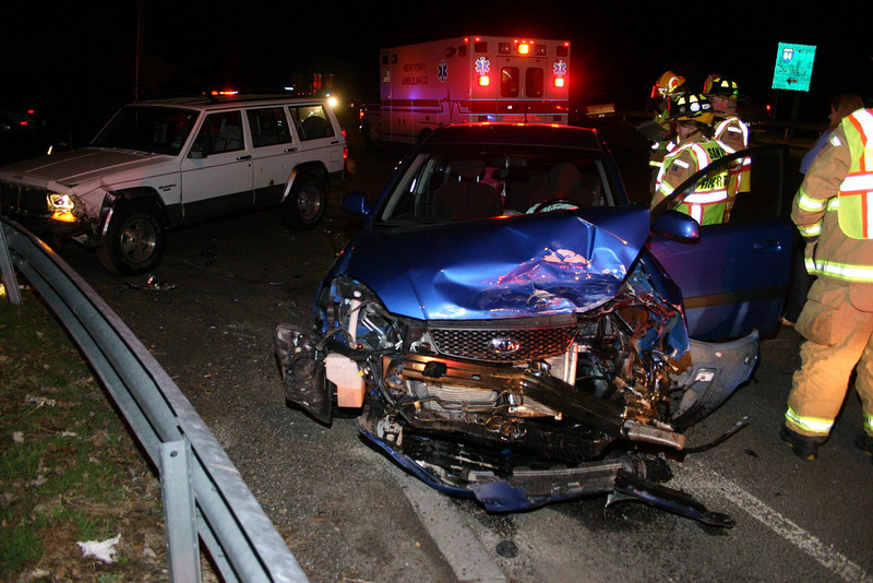 Police report a two-vehicle accident at the intersection of Church Hill Road and the Exit 10 ramps for westbound Interstate 84 at about 9:15 pm March 18. Motorist Matthew Slattery, 18, of Glover Avenue was driving a 1992 Jeep Cherokee SUV westward on Church Hill Road, as motorist Sara Marie Garcia, 22, of Bethel was driving a 2008 Kia sedan eastward on Church Hill Road, police report. The Kia then made a left turn in attempting to enter the on-ramp for westbound I-84, but in doing so, the Kia drove in front of the oncoming Jeep, resulting in a collision. Newtown Volunteer Ambulance Corps members transported Slattery to the hospital for treatment of injuries. Sandy Hook volunteer firefighters responded to the incident. Police issued Garcia an infraction for failure to grant the right of way.  (Hicks photo)