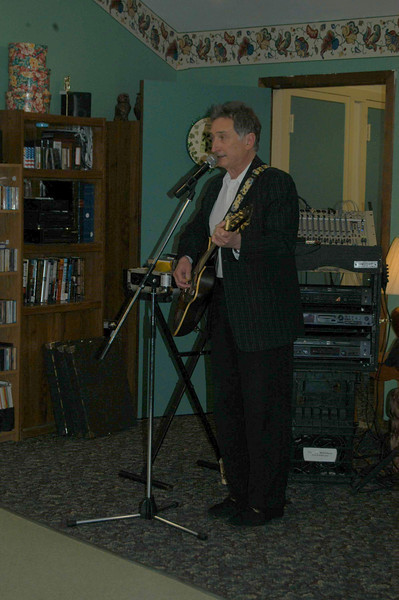 Singer Bob Mell wooed the audience at Newtown Senior Center on Monday, March 15, with a medley of favorites and Irish tunes.  (Crevier photo)