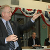 Danbury Mayor Mark Boughton, who is also among a field of declared Republican gubernatorial candidates, gestures toward the audience as fellow candidates Tom Foley and Larry DeNardis look on. The local GOP hosted five declared candidates for the state's top office this week, during a forum at Newtown Senior Center.  (Voket photo)