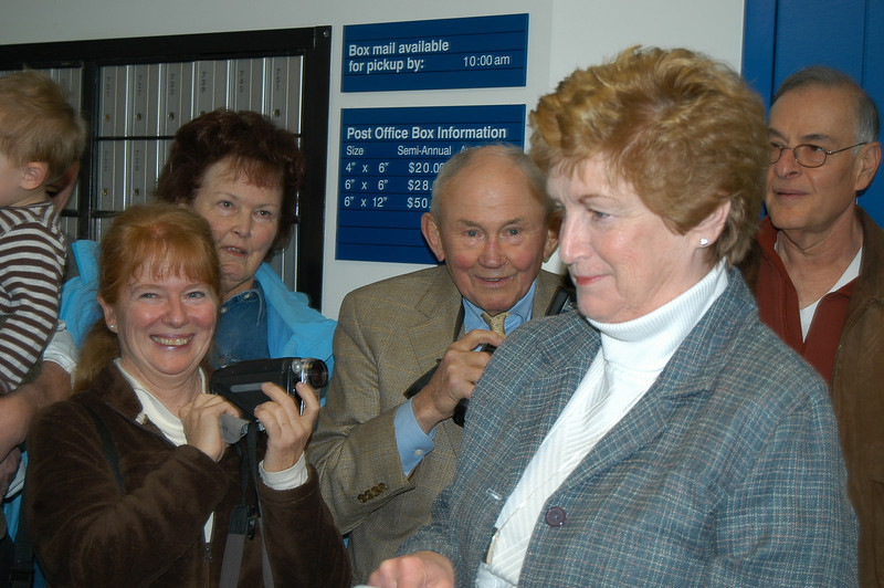 Governor M. Jodi Rell enters the lobby of the Hawleyville Post Office Monday morning, March 22, to the delight of residents and supporters gathered there to celebrate the reopening of the post office this month. Gov Rell spoke to the crowd, praising the community effort that prevented the area from losing its historic postal facility.  (Crevier photo)