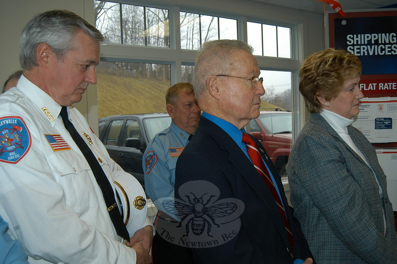 From left,  Hawleyville Volunteer Fire Company Chief Joe Farrell, former Chief Engineer Ray Fuller,  former First Selectman Joe Borst and Governor Rell listen during the grand reopening ceremony at Hawleyville Post Office on March 22.  (Crevier photo)
