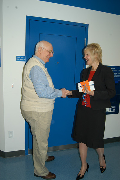 Tom Campbell accepts congratulations from Save Hawleyville Post Office committee organizer Ann Marie Mitchell on Monday, March 22. Mr Campbell guessed closest to the correct date for the reopening of Hawleyville Post Office, and received gift cards from various Hawleyville businesses for his efforts. He guessed his birth date of February 23. The post office actually reopened March 15.  (Crevier photo)
