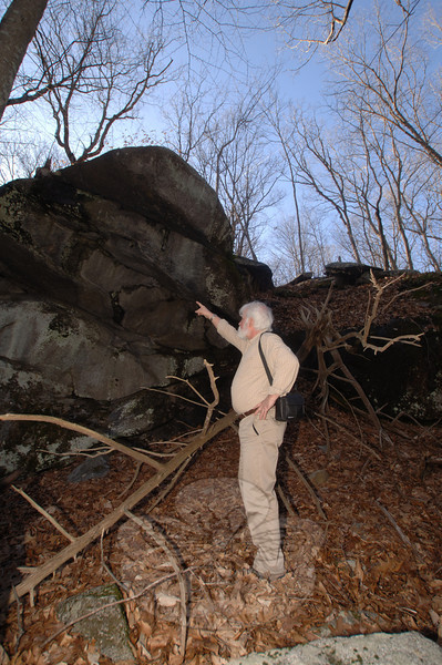 A large stone overhang running more than 20 feet above his head would have made an ideal impromptu shelter for Indians on foot in the forest, according to Town Historian Dan Cruson.  (Bobowick photo)