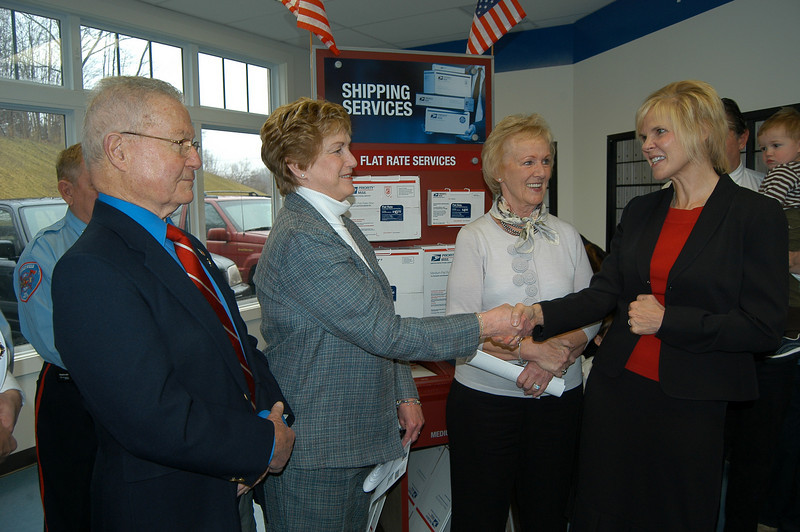 Gov Rell, second from left, congratulates Save Hawleyville Post Office committee organizer Ann Marie Mitchell, as former Newtown selectman Joseph Borst, left, and Newtown First Selectman Pat Llodra look on.  (Crevier photo)