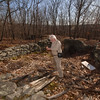 Setting foot inside a foundation near the end of Stonebridge Road, Town Historian Dan Cruson guesses the structure would have served as an outbuilding.  (Voket photo)