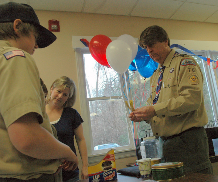 Troop Committee member Kevin Cragin hands out raffle tickets to attendees as they arrived Saturday to celebrate 100 years of Scouting with Newtown's Troop 70, which is sponsored by Cullens Youth Association.  (Voket photo)