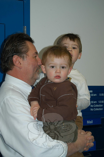 Hawleyville Postmaster Mark Favale was jined by family members, including his grandsons, during the grand reopening of his post office on March 22.  (Crevier photo)