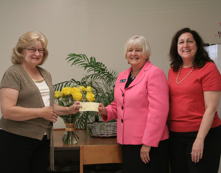 Sharon Maynard and Anne Ragusa visited the office of Newtown Social Services on June 28 to deliver a check on behalf of The Newtown Fund. Ann Piccini, left, the director of Social Services, received the check for $2,500. Ms Maynard, center, treasurer for The Newtown Fund, and Ms Ragusa, the fund's vice president, explained that the donation had been earmarked for the Social Services Camp Fund. This money, the ladies explained, is so that Social Services can help pay for kids who could not otherwise afford to go to town-sponsored summer camp programs without some financial help.   (Hicks photo)