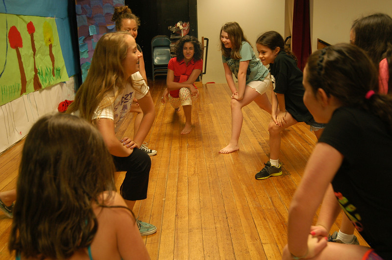 Newtown Continuing Education SMART (Summer Music and Arts) Theater and Performing Arts Workshop instructors Jane Ellen Anderson, left foreground, and Meagan Preis, left background, worked with students on the first day of the program, Monday, July 2.  (Hallabeck photo)
