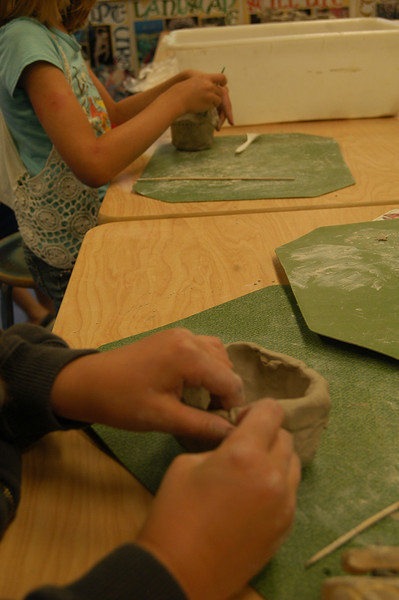 Students worked on clay creations Monday, July 2, in Newtown Continuing Education's SMART Great Clay Adventure program.    (Hallabeck photo)