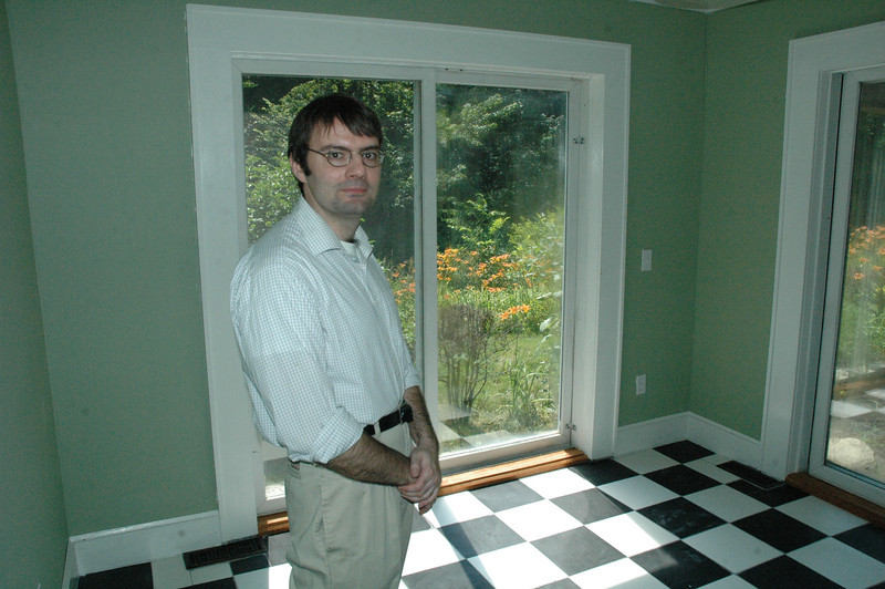 Hans S.B. Roegele, an architectural designer, stands in the entry room for a detached accessory apartment whose construction he oversaw at the Roegele property on Chestnut Hill Road in Sandy Hook. (Gorosko photo)