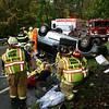 September 27, 2009: Sandy Hook firefighters, as well as ambulance volunteers and police, responded about 3:16 pm Sunday afternoon to the scene of a one-vehicle accident on westbound Berkshire Road (Route 34) near its intersection with Sherman Street. Steven Rawson, 39, of Warwick, R.I., was driving a 2005 Dodge Grand Caravan minivan, which was carrying three Rawson children as passengers, when he lost control of the vehicle on the wet roadway and then went up an embankment, after which the vehicle rolled over several times. Steven Rawson, as well as the Rawson children, Thomas, 12; Hunter, 7; and Caitlen, 5, all were treated at the scene and then transported to Danbury Hospital. Police Mr Rawson an infraction ticket on charges of traveling too fast for conditions, making a restricted turn, failure to carry an automotive insurance identification card, and failure to secure a child in a child-restraint system. (Bee Photo, Hicks)