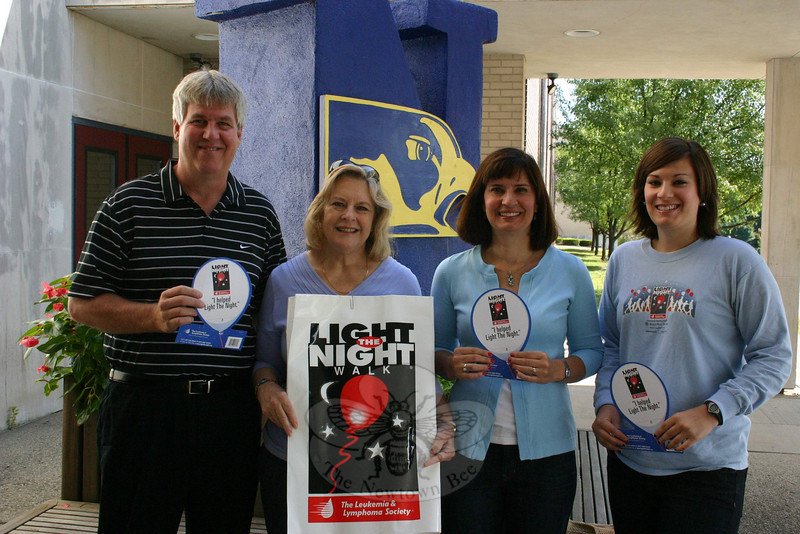 The Leukemia & Lymphoma Society (LLS) has downsized its Light The Night events this year, but local enthusiasm to help raise funds against blood cancers is as strong as ever. Ginny Chion, second from left, and Colette Ercole, third from left, are co-chairing a Mini Light the Night Walk Celebration that is being planned for Saturday, October 24, at Newtown High School. Participants are beginning to sign up already, and a website has been created at pages LightTheNight.org/CT/Norwalk09/Gchion_LTN with full details about the event and how to support the walk. NHS Athletic Director Greg Simon, on the left, and acute lymphocytic leukemia survivor Christina Ercole, right, and her mom are all holding paper balloons which can be purchased at Bagel Delight, Carminuccio's and Newtown High School for anyone interested in supporting LLS research. For additional information about Newtown's Mini Light The Night Walk Celebration, contact Mrs Chion at 426-0851, Mrs Ercole at 426-9035, or visit the aforementioned website. (Bee Photo, Hicks)