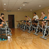 September 26, 2009: Club NewFit members burned off some calories on stationary bicycles known as spinners in an exercise room at the club on Commerce Road during the club's grand opening event last weekend. (Bee Photos, Gorosko)