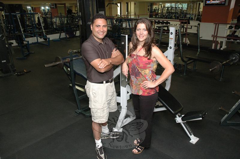 September 26, 2009: The proprietors of Club NewFit on Commerce Road, Tom and Penny Tavar stand among the facility's array of exercise equipment during the club's grand opening. Andy Gorosko will have a story about the club's recent renovations and its celebration in an upcoming issue of The Newtown Bee. (Bee Photo, Gorosko)