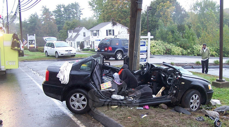 September 27, 2009: Motorist Luciana Pugliese, 17, of Brookfield was driving a 1999 Volkswagen Pas-sat northward near 90 South Main Street on wet pavement about 1:57 pm Sunday afternoon, when she lost control of the auto and then skidded sideways into an embankment along the right road shoulder, police said. The driver's side of the sedan then collided with a utility pole. Botsford and Hook & Ladder firefighters went to the accident to extricate the driver from the heavily damaged car. Ambulance vol-unteers transported Miss Pugliese to Danbury Hospital for treatment of leg injuries. She was also is-sued an infraction for driving with unsafe tires. (Botsford Fire Rescue photo)