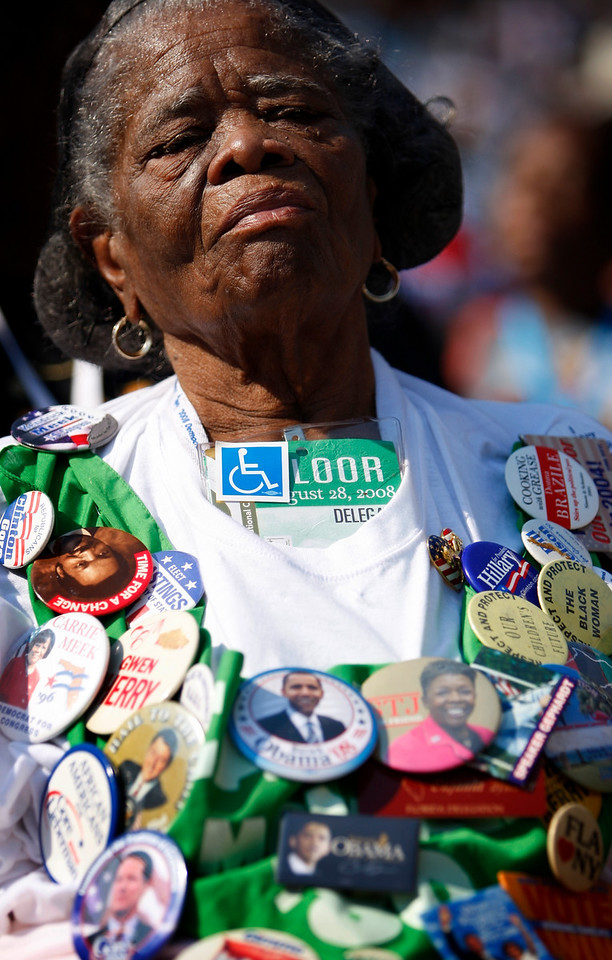 8/28/08 - Denver, CO - Invesco Field - Democratic National Convention - Eufaula Frazer, cq, 83, a delegate from Miami, FL proudly displayed buttons dating back from 1976. She has been a delegate for 10 conventions in a row. Senator Barack Obama will address an estimated crowd of 75,000 on the final night of the Democratic National Convention in Denver, CO on Thursday, August 28, 2008. Dina Rudick/Globe Staff.