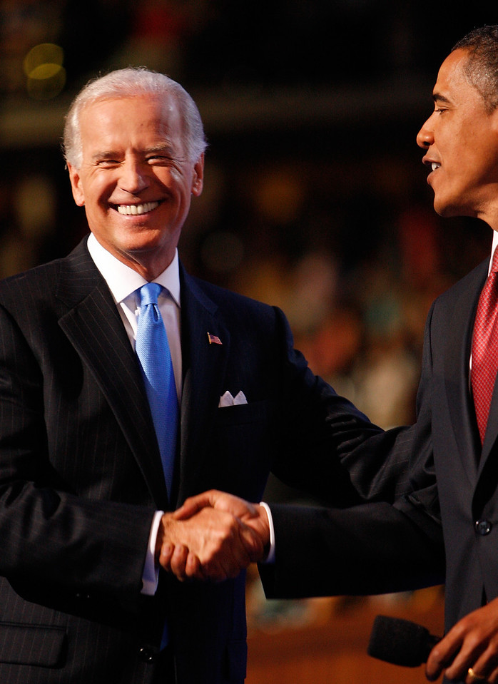 8/27/08 - Denver, CO - Pepsi Center - Senator Joseph Biden, left, accepted the nomination for the vice presidential spot on the Democratic ticket on Wednesday night, August 27, 2008.  To right is Barack Obama and in the middle is Jill Biden. Dina Rudick/Globe Staff.