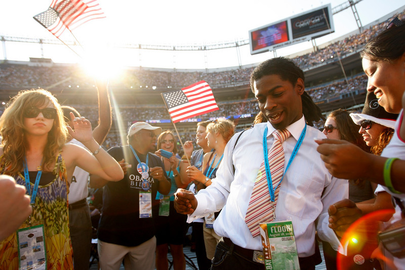 8/28/08 - Denver, CO - Invesco Field - Democratic National Convention -<br /> The crowd near the Washington state delegation erupted with dancing whenever the music played. <br /> Senator Barack Obama will address an estimated crowd of 75,000 on the final night of the Democratic National Convention in Denver, CO on Thursday, August 28, 2008. Dina Rudick/Globe Staff.