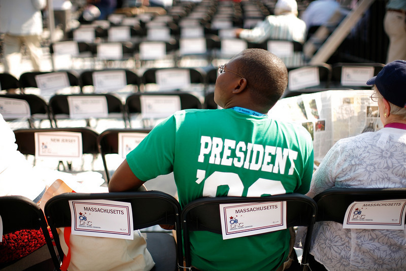 "8/28/08 - Denver, CO - Invesco Field - Democratic National Convention - Shawn Robinson, cq, a delegate from Easthampton, MA, waits for the action to start at Invesco Field. It's his first time being a delegate and ""the first time even knowing how the process works!"" he said. <br />  Senator Barack Obama will address an estimated crowd of 75,000 on the final night of the Democratic National Convention in Denver, CO on Thursday, August 28, 2008. Dina Rudick/Globe Staff."