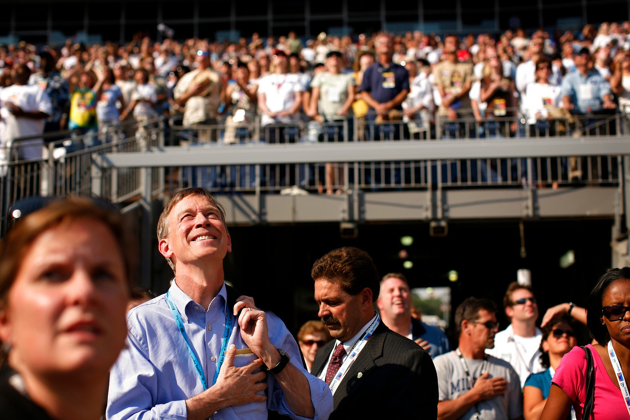"8/28/08 - Denver, CO - Invesco Field - Democratic National Convention - Denver Mayor John Hickenlooper held his hand over his heart and enjoyed the show as Jennifer Hudson sang the National Anthem at Invesco Field in advance of the fourth and final night of the DNC. ""It's 45 years from the Dream to Denver and I think we're going to see just how far this nation has come in 45 years,"" he said.  <br /> Senator Barack Obama will address an estimated crowd of 75,000 on the final night of the Democratic National Convention in Denver, CO on Thursday, August 28, 2008. Dina Rudick/Globe Staff."