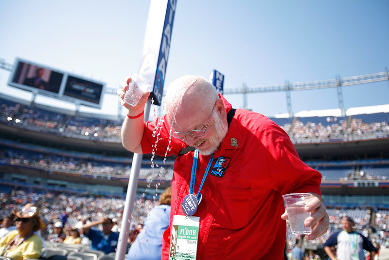 "8/28/08 - Denver, CO - Invesco Field - Democratic National Convention - Bill Monroe, cq, a delegate from Fulton, MO, gave himself some relief from the sun after he had been dancing. ""It got me hot and thristy!"" he said. ""We are all fired up and ready to go!"" he added.<br /> <br />   Senator Barack Obama will address an estimated crowd of 75,000 on the final night of the Democratic National Convention in Denver, CO on Thursday, August 28, 2008. Dina Rudick/Globe Staff."
